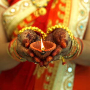 Indian woman holding Diwali oil lamp