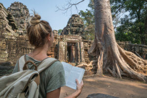 A student reading textbook outside the temple